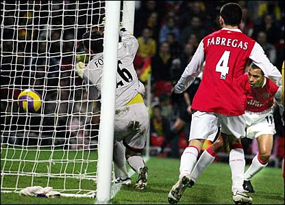 Arsenal's Gilberto Silva (right) heads Arsenal in front past Watford keeper Ben Foster (left)