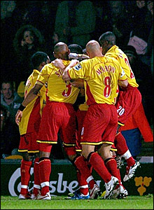 Watford players congratulate Tommy Smith after his equaliser against Arsenal