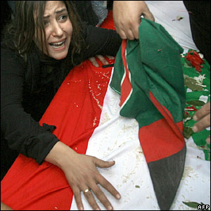 The fiancee of 20-year-old Ahmad Mahmud, named only as Sawsan, grieves over his coffin during his funeral in Beirut