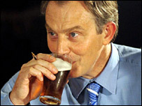 Tony Blair drinking a pint