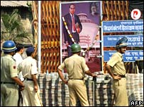 Police stand guard in front of poster of BR Ambedkar in Mumbai