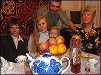 Student with his family eating a meal at a home