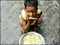 Small child eating a plate of food