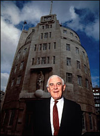 Lord Hussey in 1991, in front of the BBC's Broadcasting House in London
