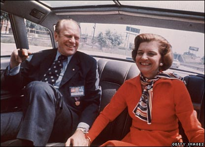 Mr Ford laughs with his wife, Betty, in a car in an image from 1975