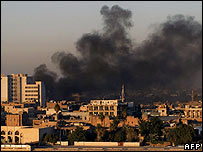 Smoke rises over Baghdad after three car bombs explode in December