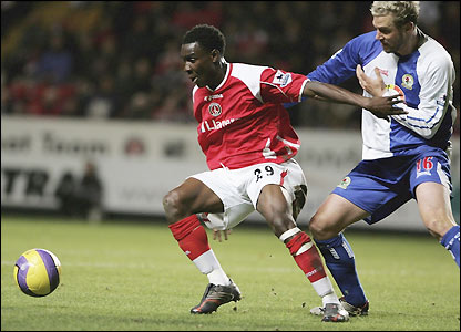 Lloyd Sam holds off Blackburn's Stephane Henchoz