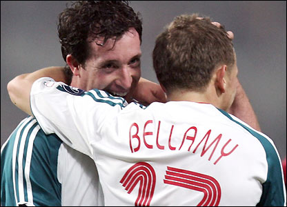 Robbie Fowler celebrates with Craig Bellamy