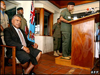 Jona Senilagakali (l) listens to Cmdr Bainimarama (r) after being sworn in as prime minister
