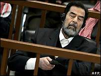 Saddam Hussein listens to translation in court 6 December 2006