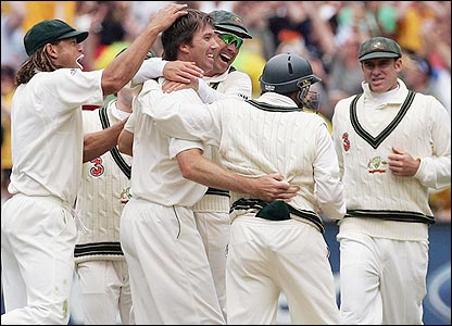 Glenn McGrath celebrates with his team-mates after trapping Ian Bell lbw