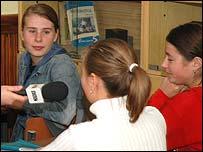 Children in Cainari talk to the BBC