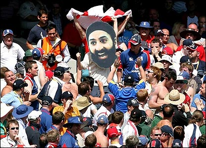 As the wickets tumble, England's fans remain upbeat, touting this enormous cut-out of Monty Panesar