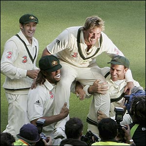 Shane Warne is carried by Andrew Symonds (left) and Matthew Hayden