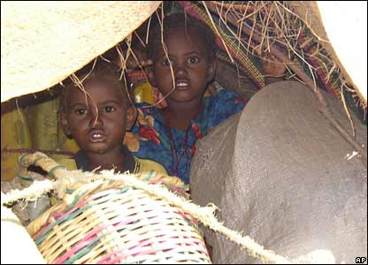 Two Somali children with their belongings ride on a donkey cart near the town of Buur on 24 December 2006