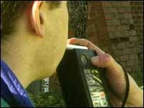 Man using breathalyser