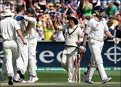 England captain Andrew Flintoff (left) departs for 26 while the Australian players celebrate