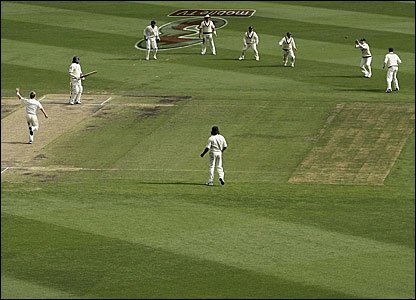 Michael Clarke (second right) takes the catch to dismiss Monty Panesar (second left) while Brett Lee celebrates