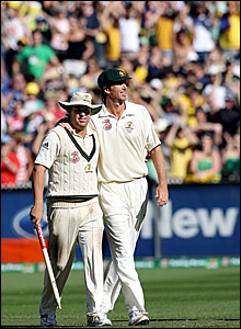 Shane Warne (left) and Glenn McGrath leave the MCG for the final time as players