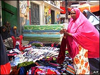 Somali woman purchases cloth at Bakara Market, Mogadishu