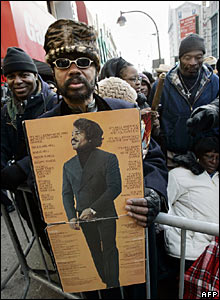 Desi Middleton holds the James Brown Hell album as he waits outside the Apollo theatre in Harlem