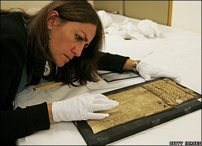 A restorer works on the collection in France
