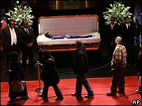 Fans file past the body of James Brown, lying in state at the Apollo Theater, Harlem