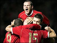 Wayne Rooney leads the celebrations
