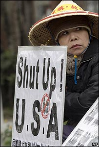 Protester opposing the US arms deal, outside the Taiwanese legislator in Taipei on 29 December 2006