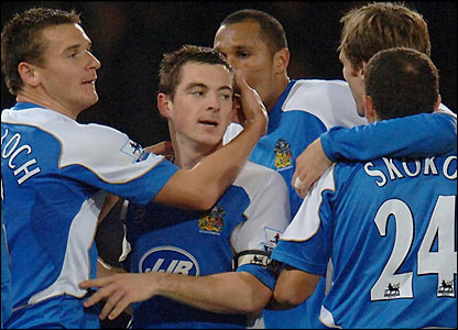 Leighton Baines celebrates with his team-mates