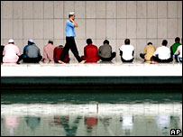Muslims take part in Friday prayer at the National Mosque in Kuala Lumpur