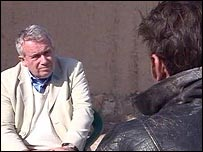 Martin Bell speaks to a former youth member of the Afghan army