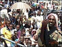 Armed Islamic court guard with Somali protesters, Mogadishu