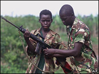 A 14-year-old soldier is taught how to use a gun in Sierra Leone (file image)