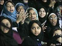 A group of girls watch the 2006 Asian games in Qatar