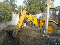 Bulldozer digging outside the house in Noida
