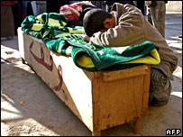 An Iraqi mourns over the coffin of a relative in Baquba, north of Baghdad