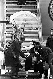Gerald Ford falls down the steps of Air Force One in Salzburg, 1975
