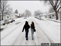 Two girls walk in Louisville, Colorado. Photo: 28 December 2006