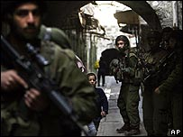 Israeli troops on patrol in Hebron in the West Bank