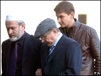 Walter Litvinenko arrives to pray for his son