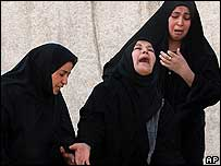 Women grieve at a Baghdad hospital after identifying relatives killed in attacks