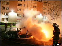 Firemen douse a burning car in the suburb of Aulnay-sous-Bois on 4 November 2005