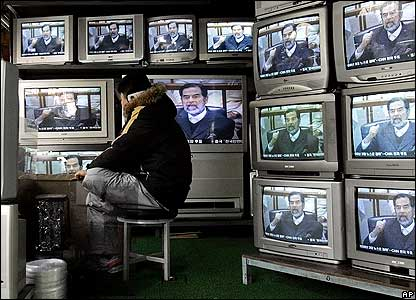 Man watching TVs in South Korea