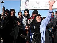 Iraqis in Sadr City, Baghdad, celebrate the execution of Saddam Hussein