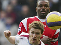 Villa's Steven Davis beats Darren Bent to the ball