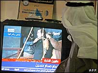 Kuwaiti man watches footage of Saddam Hussein going to the gallows
