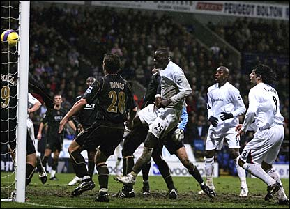 Abdoulaye Faye heads in an equaliser for Bolton