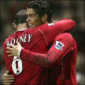 Wayne Rooney hugs Cristiano Ronaldo