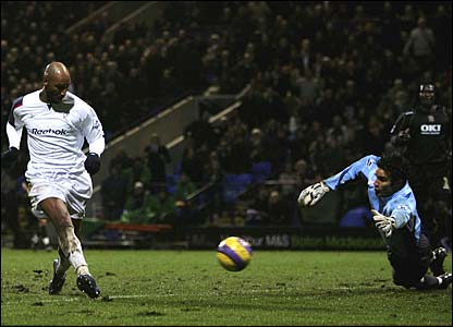 Nicolas Anelka places the ball past David James